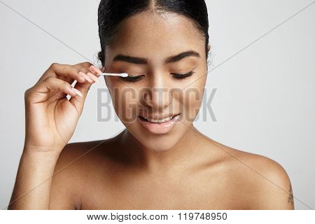 Woman With A Cotton Swab Stick Clean Her Eyelid