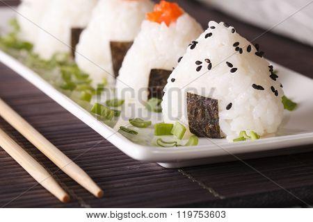 Onigiri Rice Balls Close-up On A Plate. Horizontal