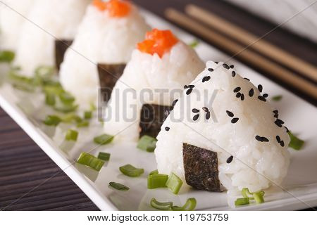 Japanese Food Onigiri Rice Balls Macro On A Plate. Horizontal
