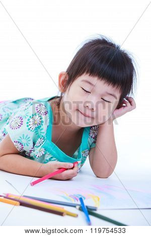 Child Lie On The Floor And Drawing On Paper.  On White