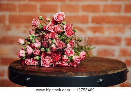 Mini Roses  On Vintage Wooden Surface