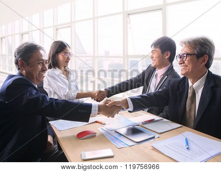 Team Of Man And Woman  Business People Successful Shaking Hand After Solution Meeting Agreement Shot