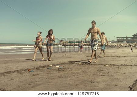 people playing tejos  in the beach
