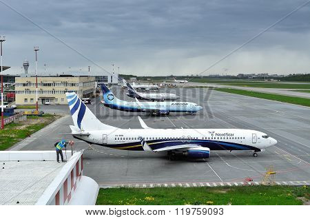 Airplanes Stand At The Parking In Pulkovo International Airport In Saint-petersburg, Russia
