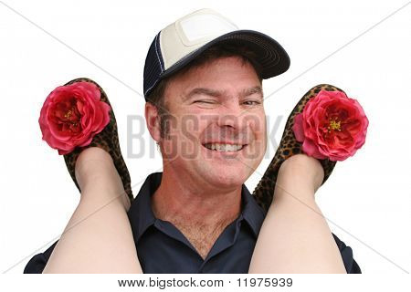 A repairman giving a wink as he provides service to a woman wearing bedroom slippers.