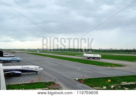 The Airplanes Of Various International Airlines On The Runway Of Pulkovo Airport In Saint-petersburg