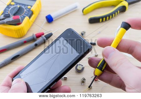 The Workplace Of Serviceman. Smartphone Repair.