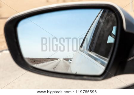 Desert Road In Qatar In Rear View Mirror