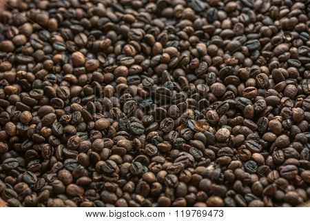 Roasted brown coffee beans, can be used as a background and texture