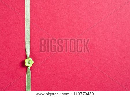 texture paper and ribbon with flower button and copy space