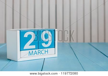 March 29th. Cube calendar for march 29 on wooden surface with empty space For text