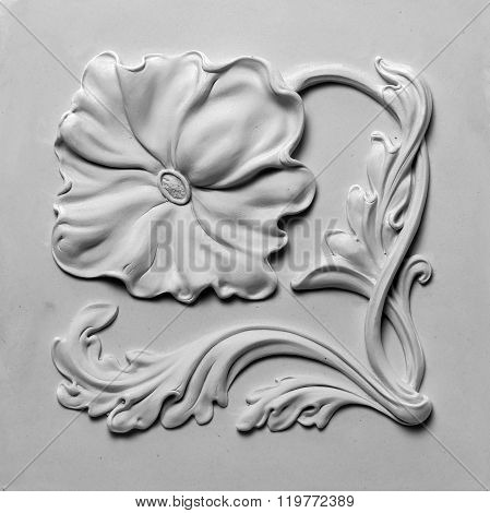 decoration item made of white plaster. relief stucco interior