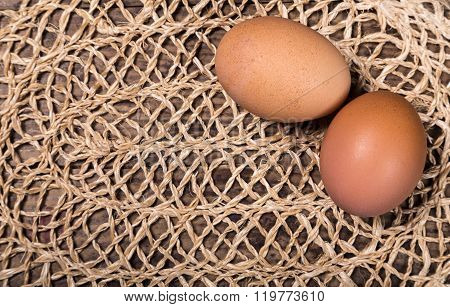 Two Eggs On The Wattled Cloth Background