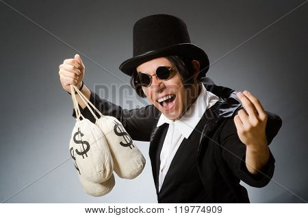 Funny man with dollar sacks