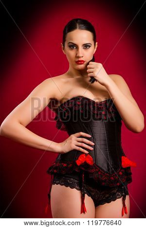 Sexy Young Woman In Black Corset