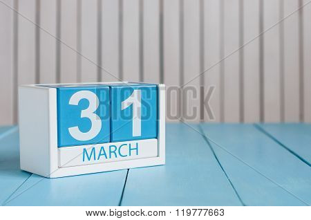 March 31st. Image of march 31 wooden color calendar on white background.  Spring day, empty space fo