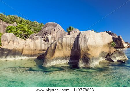 Beautifully shaped granite boulders and a perfect white sand at the famous Anse Source d'Argent beach, La Digue island, Seychelles