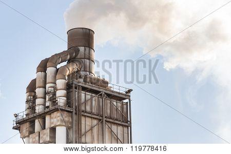 Old Smokestack That Emits White Smoke.