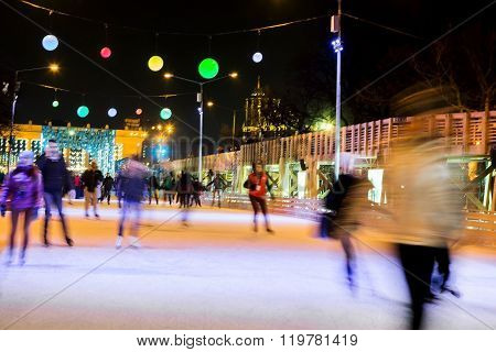 People Are Skating On Rink