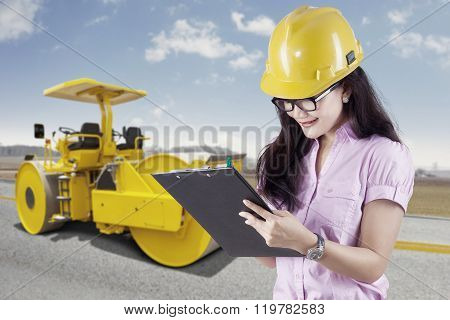 Female Engineer And Road Roller