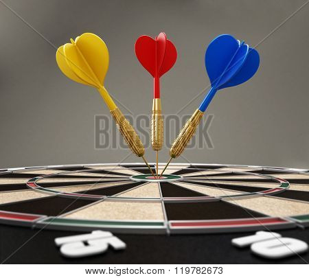 Red, Yellow And Blue Darts Hitting The Target Bull's Eye