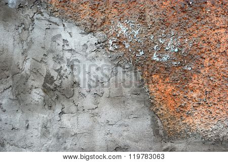 Half covered with plaster, half concrete wall