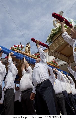 Costaleros Rinsing A Float During The Resurrection Day
