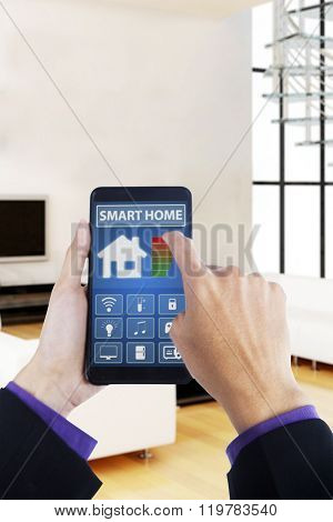 Hand Using Smartphone With Smart House App