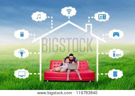 Happy Family With Smart House Technology System