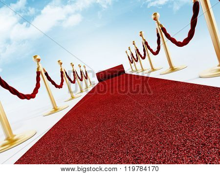 Rolled red carpet and velvet ropes against the blue sky