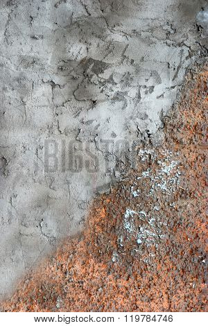 Wall background half covered with orange plaster