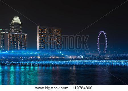 Marina Bay Singapore, Floating Blue Balls Reflect On The Water At Night.