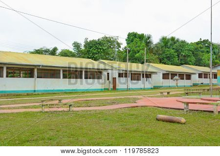 SANTA ANA VILLAGE, PERU - OCTOBER 14, 2015: School buildings. The colorful buildings serve the community in the remote area of the Peruvian Amazon.