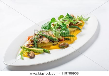 Baked fish King clip with vegetables and sauce. Close-up