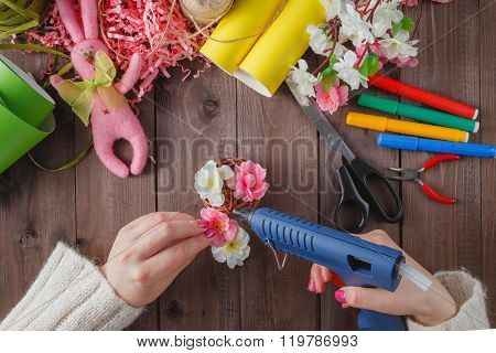 Woman Glue Handmade Flowers With Melt Gun