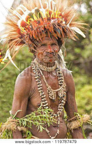 Village tribal man wearing bird of paradise head dress