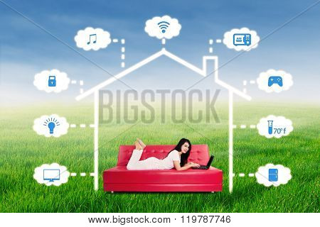 Woman With Laptop To Control Smart House