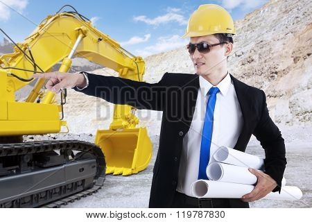 Young Foreman And Excavator