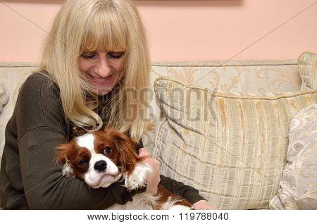 Lady Cuddling Dog