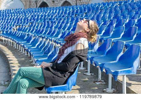 Bored Girl Sleeping While Waiting A Concert