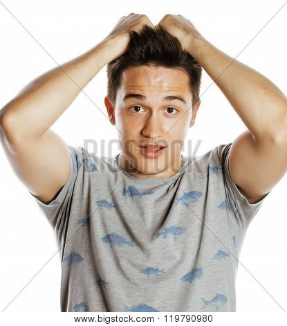 Young attractive handsome man holding hands on his head emotional wondering isolated on white