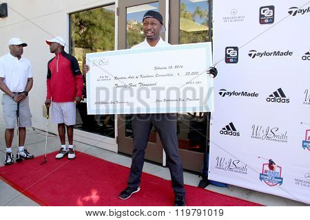Ricky Smith and a check from the Will and Jada Smith Foundation at the inaugural Stephen Bishop celebrity golf invitational benefiting R.A.K.E.,  Feb. 15, 2016 , Calabasas Country Club, Calabasas, CA.