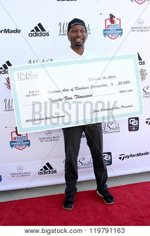 Ricky Smith with a donation )Will and Jada Smith Foundation) at the inaugural Stephen Bishop celebrity golf invitational to benefit R.A.K.E. , Feb. 15, 2016 at Calabasas Country Club in Calabasas, CA.