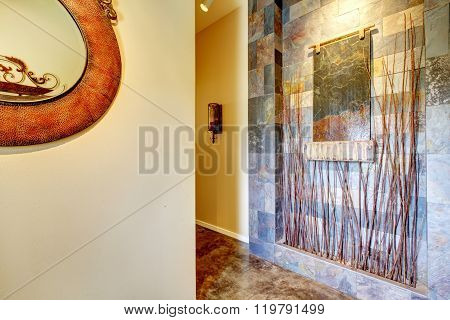 Decorative Hallway With Tile Fountain Wall Display.
