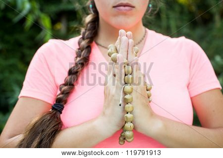 Woman  Holds A Rosary In His Hands And Pray