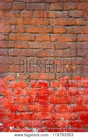 Painted brick wall half brown half red color. Good frame for text.