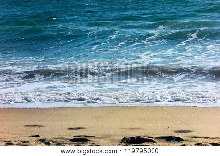 Simple Pleasure of Wet Sand and Waves