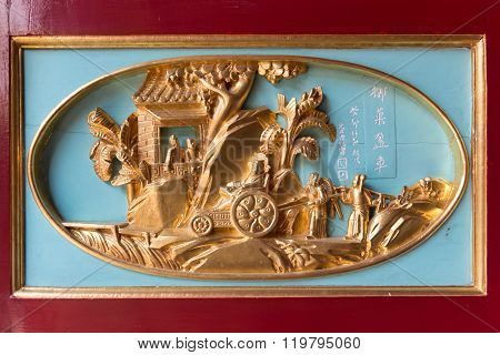 Finely Detailed Gold Relief Sculpture On The Door Of Canton Shrine