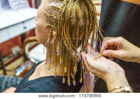 Making braids at hair dresser