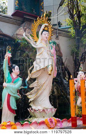 Ceramic Statue Of Kuan Yin, The Goddess Of Mercy Inside Li Thi Miew Shrine